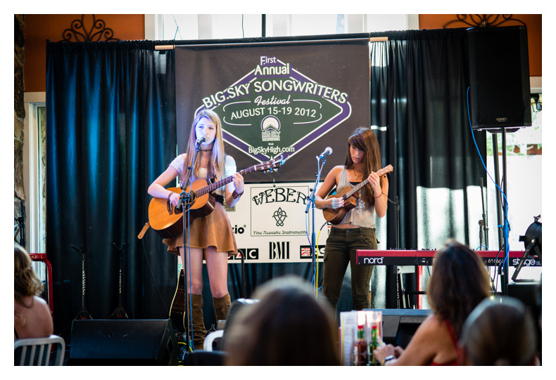 Attendees perform at the songwriter showcase.
